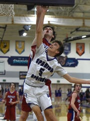 Spanish Springs' Brock OConnell goes up to shoot with
