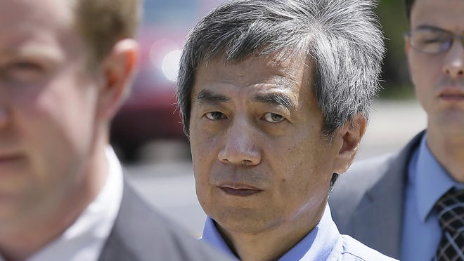 Former Iowa State University researcher Dong-Pyou Han leaves the federal courthouse in Des Moines, Iowa on July 1, 2014.