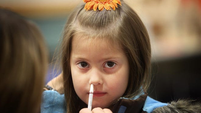 Lucy Durst at North Marion Elementary gets a FluMist vaccine in 2009. The Advisory Committee on Immunization Practices with the Centers for Disease Control rescinded its prior endorsement of the product.