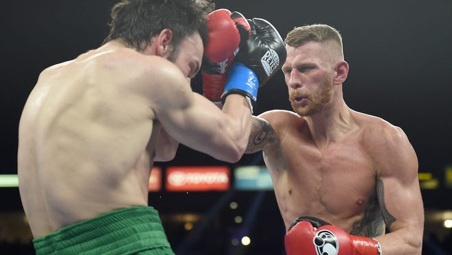 Andrzej Fonfara , right, punches Julio Cesar Chavez Jr. to a ninth-round TKO (Photo: Harry How, Getty Images)