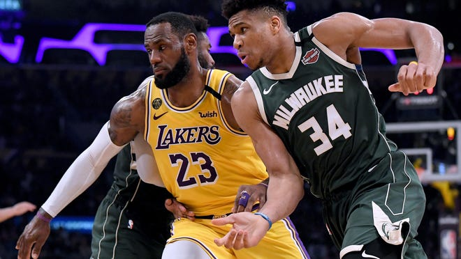 Los Angeles' LeBron James (23) and Milwaukee's Giannis Antetokounmpo have their teams well positioned to make a run at the NBA title.