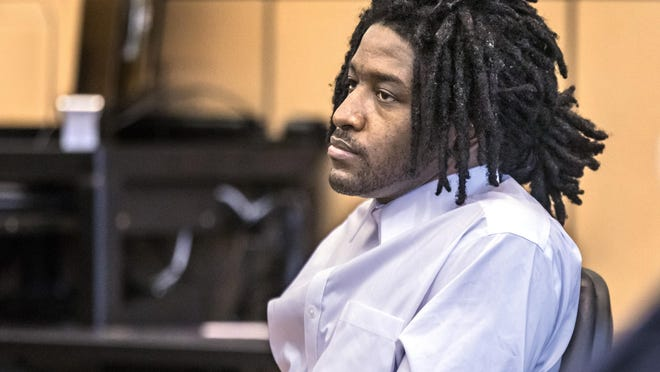 Marlin Joseph listens to the testimony of his mother, Robin Denson, during his murder trial Thursday, Feb. 20, 2020. Joseph is charged in the Dec. 28, 2017, killings of Kaladaa Crowell, 36, and her 11-year-old daughter, Kyra Inglett.