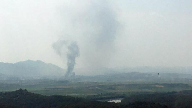 Smoke raising in the North Korean border town of Kaesong is seen from Paju, South Korea, Tuesday, June 16, 2020. North Korea blew up an inter-Korean liaison office building just inside its border in an act Tuesday that sharply raises tensions on the Korean Peninsula amid deadlocked nuclear diplomacy with the United States.