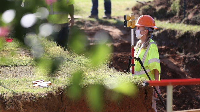 A forensic anthropologist, shown here July 22, works on a survey at Oaklawn Cemetery during a test excavation in the search for possible mass graves from the 1921 Tulsa Race Massacre.