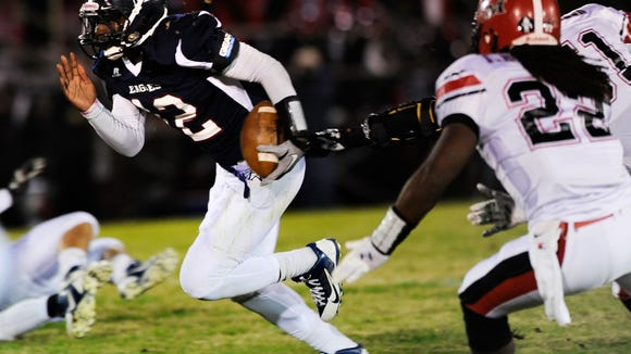 Montgomery Academy quarterback Josh Thomas carries against TR Miller at the MA Campus in Montgomery, Ala. on Friday November 14, 2014.