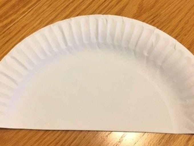Step 1:  Cut the paper plate in half.