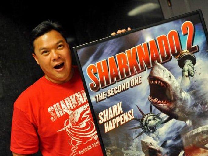 "Lyman Chen, of Brandywine Hundred, jokes around next to a ""Sharknado 2"" movie poster."