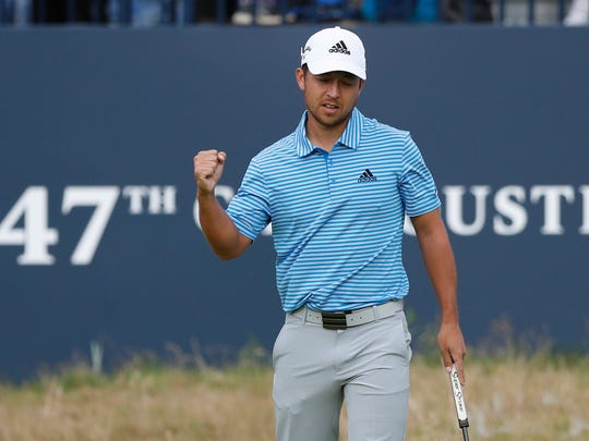 Xander Schauffele of the US after a birdie on the 18th hole during the third round of the British Open Golf Championship in Carnoustie, Scotland, Saturday July 21, 2018. (AP Photo/Alastair Grant)