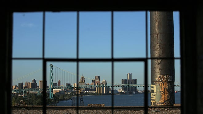 The Ambassador Bridge and downtown Detroit as photographed from an abandoned warehouse near the Delray neighborhood in Detroit on Wednesday, July 15, 2015.