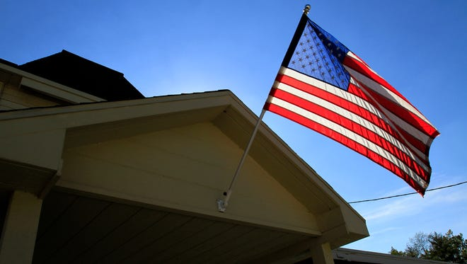 An American flag is illuminated by the afternoon sun.
