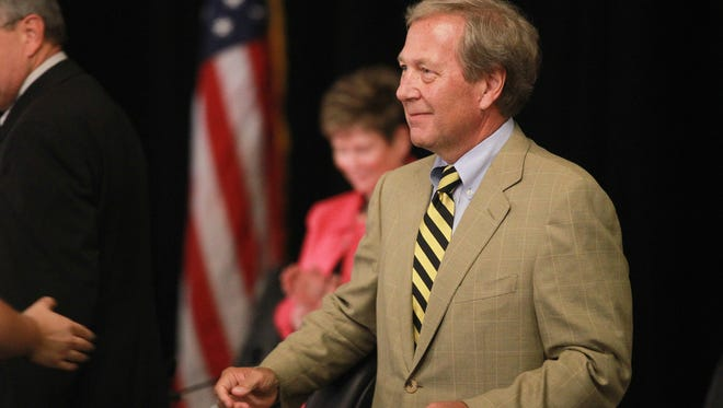 Newly appointed University of Iowa President J. Bruce Harreld greets members of the Iowa Board of Regents at the Iowa Memorial Union on Thursday, Sept. 3, 2015.