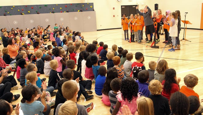 Twain Elementary students celebrate the opening of their new gymnasium on Friday, Oct. 30, 2015.