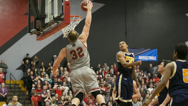 Western Oregon's Andy Avgi (32) dunks the ball in game against UC San Diego in the third round of the NCAA Division II Tournament on Monday, March 14, 2016, in Monmouth, Ore. Western Oregon won the match up 60-55 after a close game.