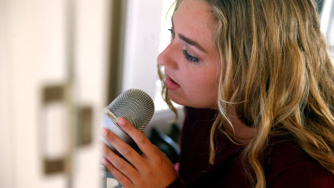 Singer Mackenzie Malpass is shown in her Point Pleasant Beach home Tuesday, September 27, 2016.  Mackenzie is a talented singer who records music that she sells online to raise money for Ocean of Love, a pediatric cancer charity in Ocean County.