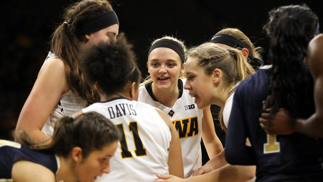 Iowa's Tania Davis huddles with teammates after drawing a foul during the Hawkeyes' game against Oral Roberts at Carver-Hawkeye Arena on Friday, Nov. 11, 2016.