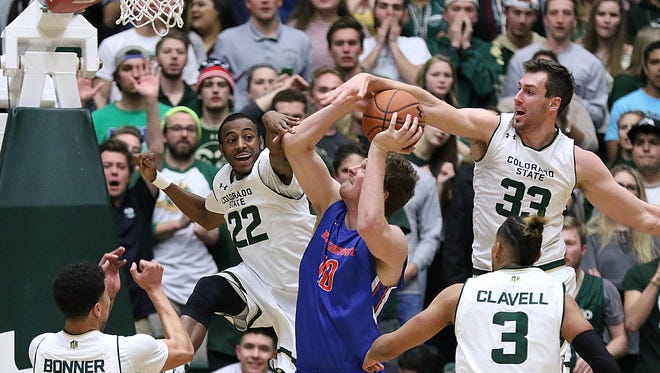 Rams J.D. Paige and Braden Koelliker combine to block a shot during the Colorado State Rams' game the Boise State Broncos on Tuesday Jan. 31, 2017, at Moby Arena in Fort Collins, Colo. The Rams were down 43-40 at halftime after making a late, 19-point comeback. The two teams came into the game tied for second place in the Mountain West Conference with the Rams on a three-game winning streak. (Photo by Brian Smith/for the Coloradoan)
