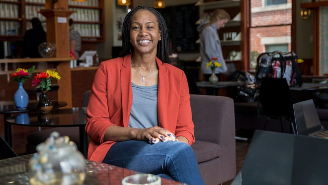 Tamika Catchings poses for a portrait inside Tea's Me Cafe on 22nd Street, Indianapolis, Tuesday, March 21, 2017. The former Indiana Fever star, whose family grew up enjoying tea as a household routine, has been going to the shop for years and came to know the owners. When Catchings heard Wayne and Stacey Ashford would be closing shop to start their next life chapter in Georgia, they decided Tamika taking over would be a rewarding option for everyone.