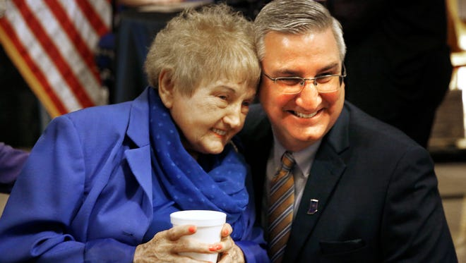 Eva Mozes Kor talks poses for a photo with Governor Eric Holcomb after receiving the 2017 Sachem Award at the Indiana War Memorial, Thursday, April 13, 2017.