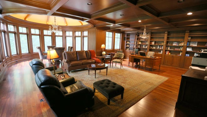 Grandest of the getaways is the 32-foot library these owners added, which is richly paneled and coffered with cherry. It is off the master bedroom.