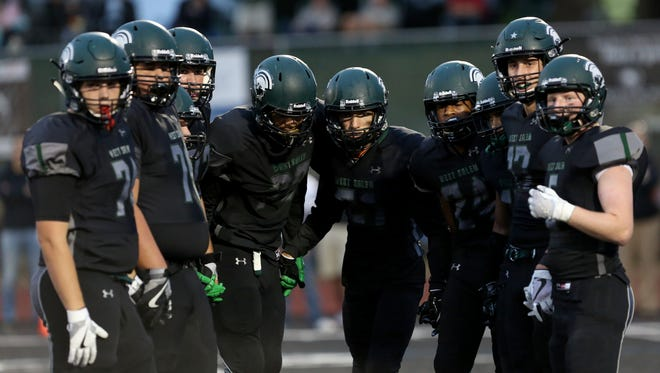 West Salem huddles before a play in the first half of the Sprague vs. West Salem football game at West Salem High School on Friday, Sept. 8, 2017.