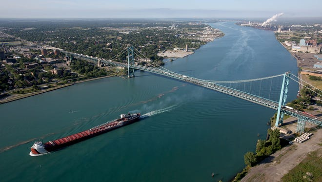 A freighter is upbound on the Detroit River after passing beneath the Ambassador Bridge, linking Detroit,Michigan with Windsor, Ontario.
