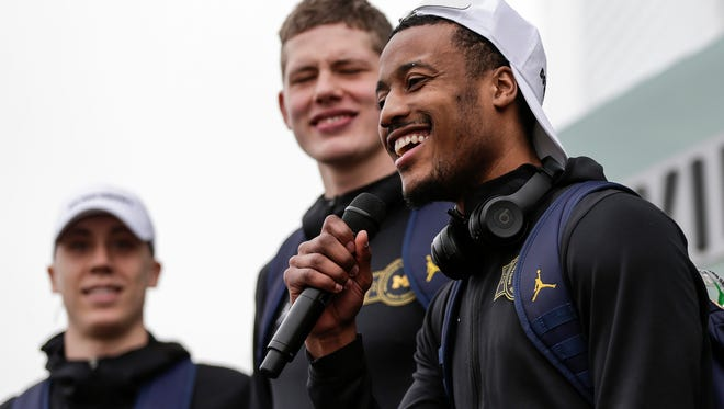 Michigan guard Muhammad-Ali Abdur-Rahkman speaks during the Final Four send off outside of Crisler Center in Ann Arbor, Wednesday, March 28, 2018. Behind him, guard Duncan Robinson, left, and forward Moritz Wagner.