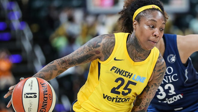 Indiana Fever guard Cappie Pondexter (25) drives past Minnesota Lynx guard Seimone Augustus (33) toward the basket during second half action at Banker's Life Fieldhouse in Indianapolis, Wednesday, July 11, 2018. The Fever lost to the Lynx, 87-65.