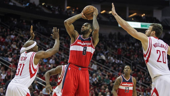 Washington Wizards forward Rasual Butler (8) shoots during the fourth quarter against the Houston Rockets at Toyota Center.