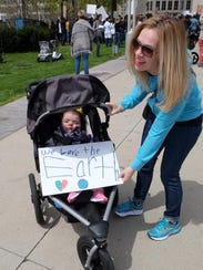 Andrea Pietrowsky and her daughter Louisa, 3, attend