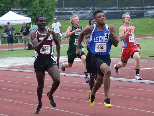 Robert E. Lee's Iyon Oravitz, center, won the 100- and 200-meter dashes at the Group 2A meet in June at Radford University.