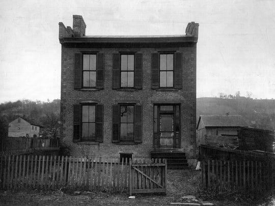 John Parker's house taken in 1910. Parker died in 1900.