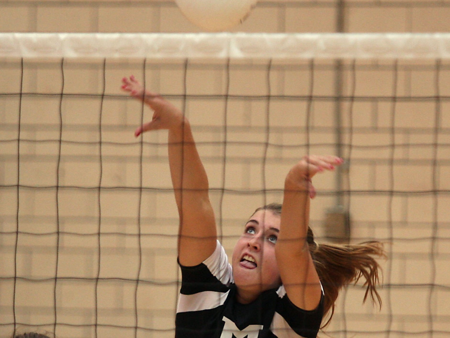 Morristown's Abby Schubiger puts the ball over the net in this file photo.
