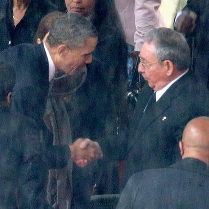 President Barack Obama shakes hands with Cuban President