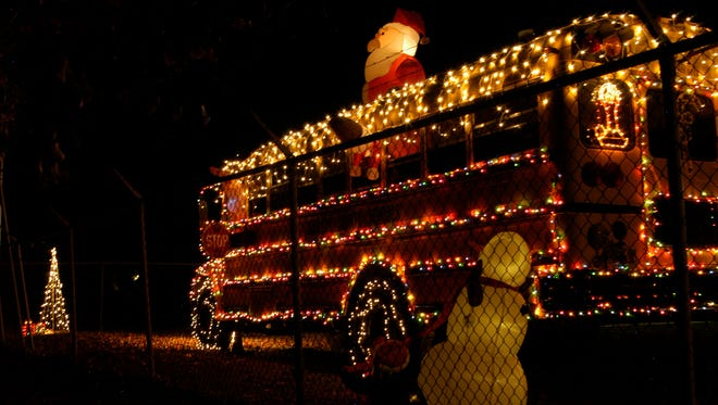 The holiday display turns on daily at dark and remains illuminated through the night at the Dickson County Schools transportation department on Sylvis Road.
