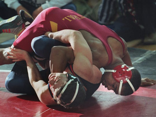 Central Regional's Mark Worthy tries to pin Washington