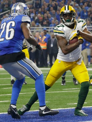 Green Bay Packers wide receiver Davante Adams scores a touchdown.