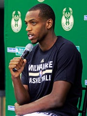 Khris Middleton talks about his hamstring injury at media day in September.