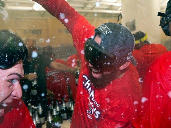 Deven Marrero celebrates in the clubhouse after the Red Sox clinched the AL East title last September.
