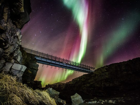 The Northern Lights dance above the Bridge Between Continents