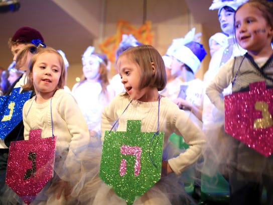 Children get into the holiday spirit at a past Chanukah