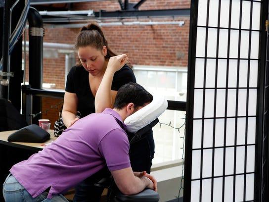 Massage therapist Melissa Miser gives media planner