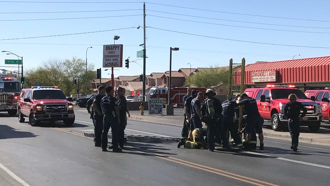 Phoenix fire crews lower a ladder to help a 50-year-old man climb up after becoming stuck in a storm drain.