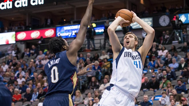 Dallas Mavericks power forward Dirk Nowitzki (41) shoots over New Orleans Pelicans small forward Al-Farouq Aminu (0) during the second half at the American Airlines Center last season.