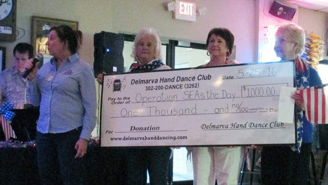 The Delmarva Hand Dancing Club donated $1,000 to Operation SEAs the Day at the Ocean City Elks Club Lodge on Wednesday, May 25. Pictured are Annette Reeping of Operation SEAs the Day (left), president Barbara Chaffinch, treasurer Joanne Arter and secretary Janie Filloramo of the Delmarva Hand Dancing Club.