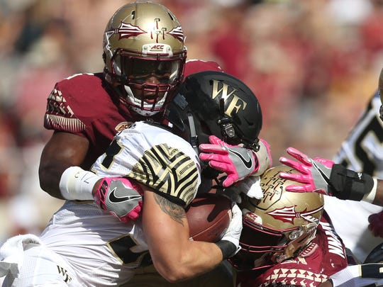 FSU's Dontavious Jackson tackles Wake Forest's Cade Carney for a loss on the first play of the game in the Seminoles 17-6 homecoming win at Doak Campbell Stadium on Saturday.