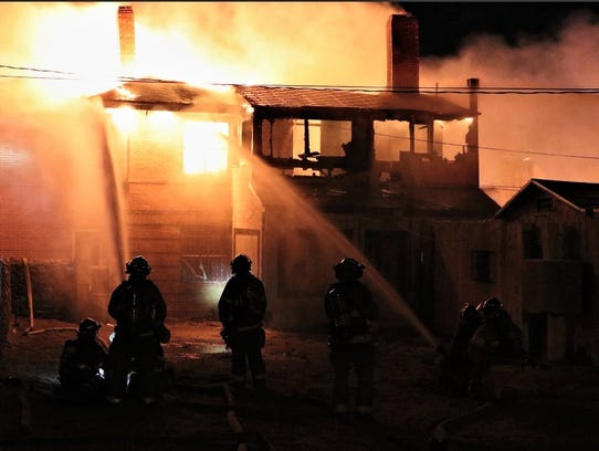 El Paso firefighters battle a two-alarm fire that destroyed