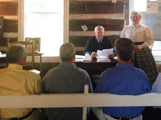 Hardeman County Mayor Jimmy Sain conducts a meeting in the county's Little Courthouse in this file photo.