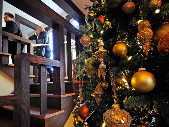 In this file photo, members of the public walk upstairs past a decorated Christmas tree at the Strzyzewski and Barry residence in the 26th annual Manitowoc Symphony Orchestra Holiday Tour of Homes in 2014.
