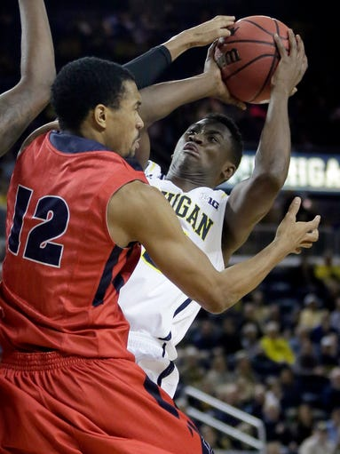 Michigan's Caris LeVert goes to the basket against