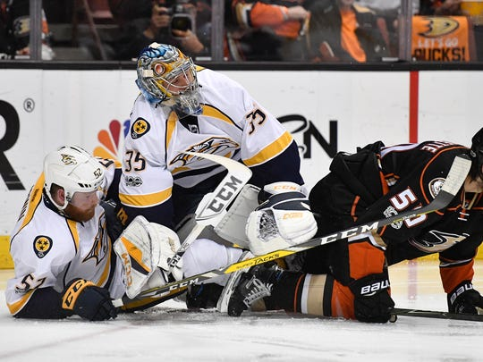 Nashville Predators goalie Pekka Rinne (35) and defenseman